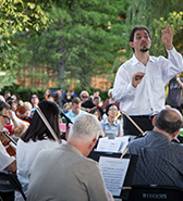 Emanuelle Andrizzi conducts a side-by-side performance in Ping-Tom Park
